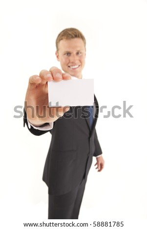 Portrait of businessman standing and holding a blank business card - stock photo