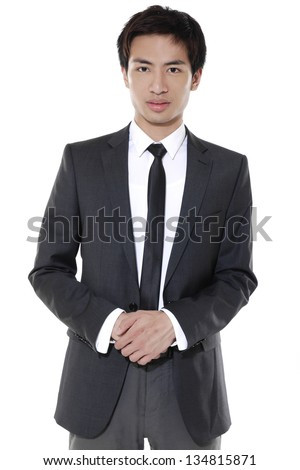 Portrait of businessman standing comfortably.