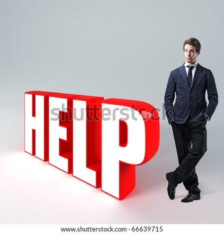 portrait of businessman standing near huge 3d help text - stock photo