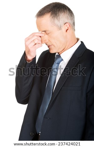 Portrait of businessman suffering from sinus pain. - stock photo