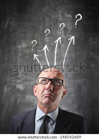 portrait of businessman undecided - stock photo