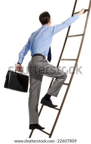 Portrait of businessman with briefcase climbing on staircase - stock photo