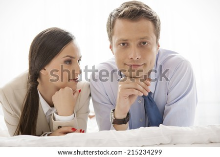 Portrait of businessman with coworker in hotel - stock photo
