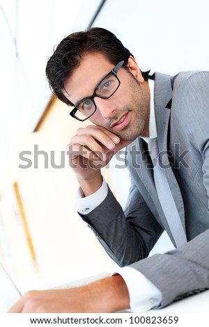 Portrait of businessman with eyeglasses - stock photo