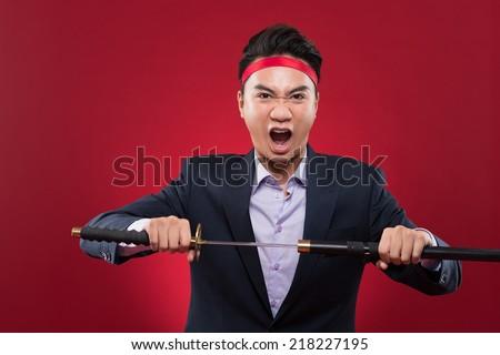 Portrait of businessman with katana sword screaming - stock photo