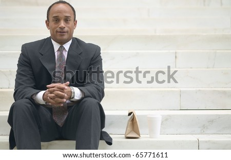 Portrait of businessman with lunch - stock photo