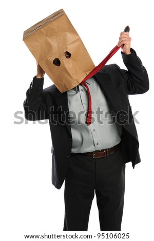 Portrait of businessman with paper bag on head pulling tie isolated over white background - stock photo