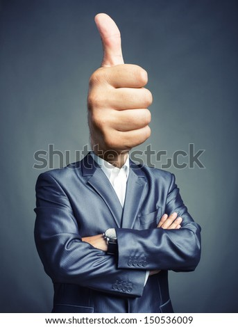 Portrait of businessman with thumbs up sign instead of the head - stock photo