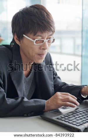 Portrait of businessman working
