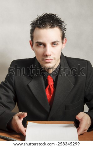 Portrait Of Businessman Writing a Paperwork at Office - stock photo