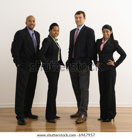 Portrait of businessmen and businesswomen standing smiling.