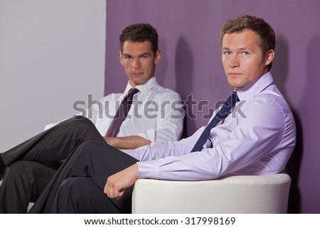 Portrait of businessmen sitting at office