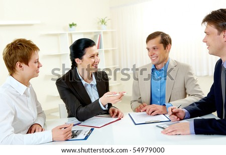 Portrait of businesswoman explaining work to colleagues in the boardroom - stock photo