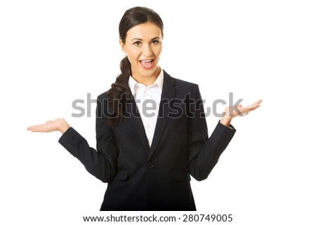 Portrait of businesswoman holding copyspace. - stock photo