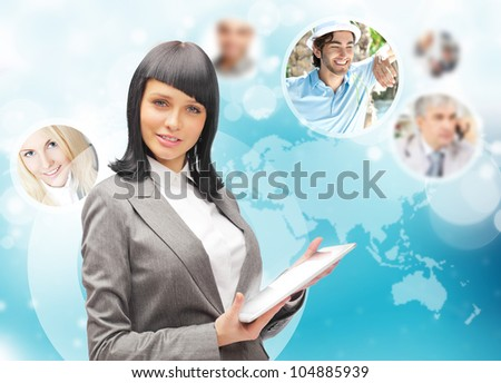 Portrait of businesswoman holding her tablet computer and communicating with her team across the world. International communications concept