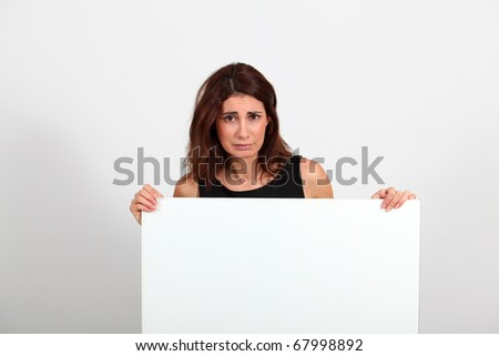 Portrait of businesswoman holding whiteboard