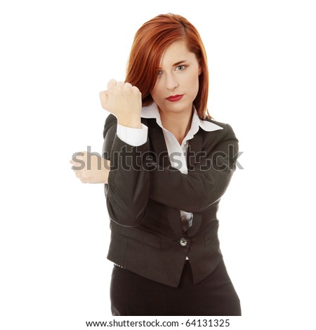 Portrait of businesswoman in suit showing fist gesture, isolated on white background
