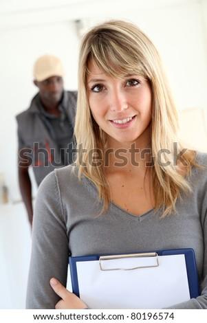 Portrait of businesswoman in warehouse - stock photo