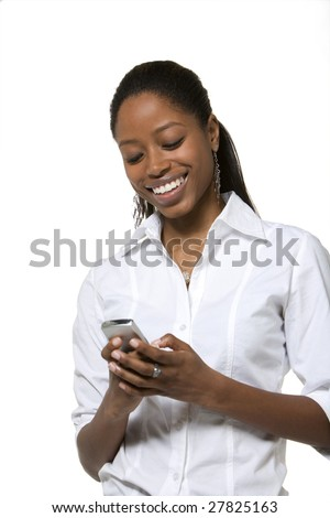 Portrait of businesswoman looking at cell phone - stock photo
