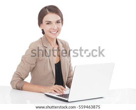 portrait of businesswoman smiling while working on her laptop at office isolated on white background