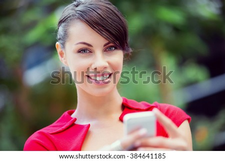Portrait of businesswoman with mobile phone - stock photo
