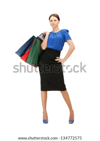 portrait of businesswoman with shopping bags on high heels