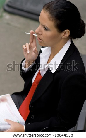portrait of businesswoman with sigarette - stock photo
