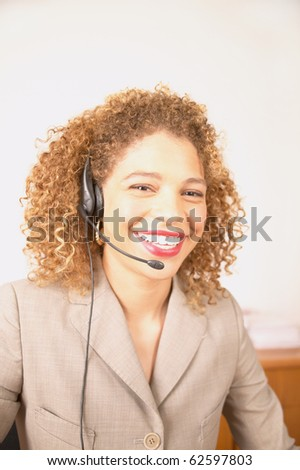 Portrait of businesswoman with telephone headset - stock photo