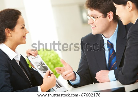 Portrait of busy companions discussing business plan and new strategy at meeting - stock photo