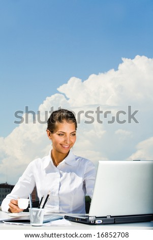 Portrait of busy entrepreneur doing some work on laptop - stock photo