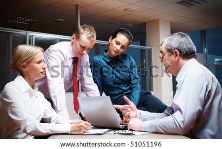 Portrait of busy partners working together in office - stock photo