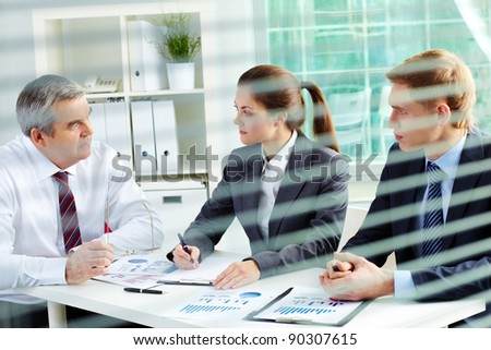 Portrait of busy people discussing new working plan at meeting in office - stock photo