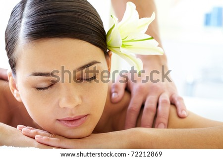 Portrait of calm female during luxurious procedure of massage - stock photo