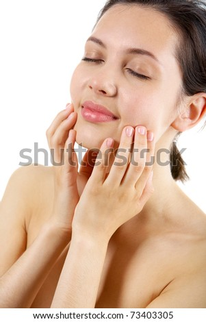 Portrait of calm female with her hands on face taking pleasure - stock photo