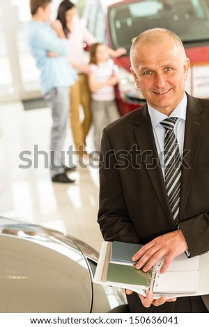 Portrait of car salesman with color swatches - stock photo
