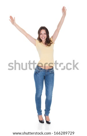 Portrait Of Carefree Young Woman With Hand Raised Over White Background
