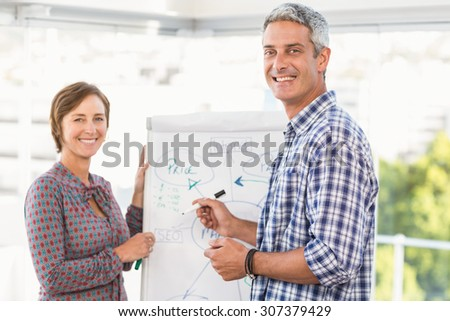 Portrait of casual business colleagues preparing presentation in the office - stock photo