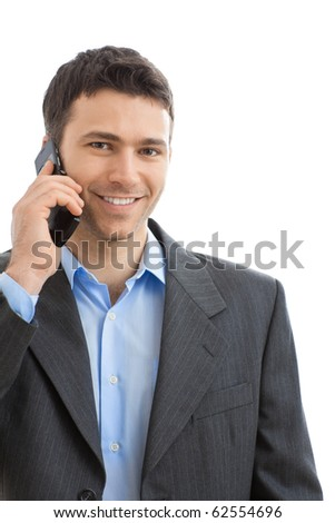 Portrait of casual businessman talking on mobile phone. Isolated on white. - stock photo