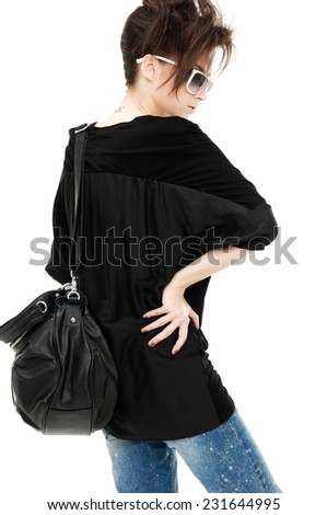 portrait of casual fashion woman with bag back posing - stock photo