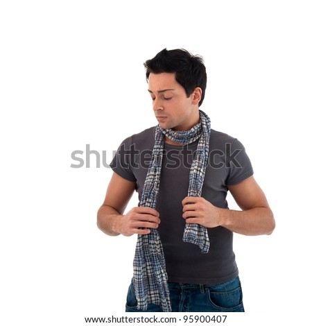 Portrait of casual man wearing scarf against white background.