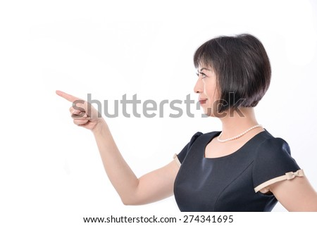 Portrait of Casual woman pointing with her finger - stock photo