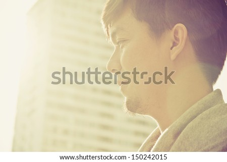 portrait of casual young asian man at sunrise - stock photo