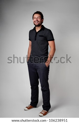Portrait of casual young man. Standing with hands in the pocket