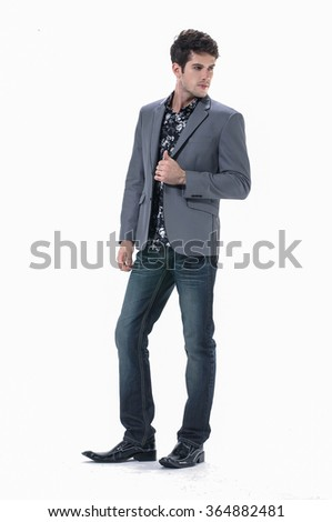 Portrait of casual young man, walking on light background - stock photo