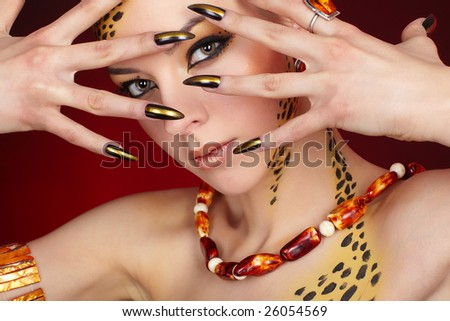 Portrait of Cat - Girl in leopard bodyart - stock photo