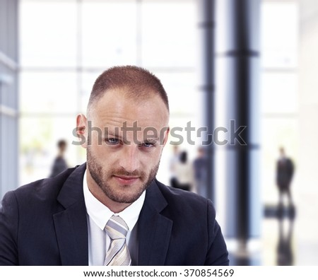 Portrait of caucasian businessman looking at camera - stock photo