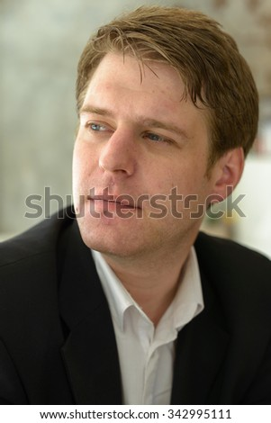 Portrait of Caucasian businessman sitting in coffee shop