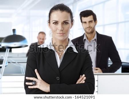 Portrait of caucasian businesswoman standing in office. - stock photo