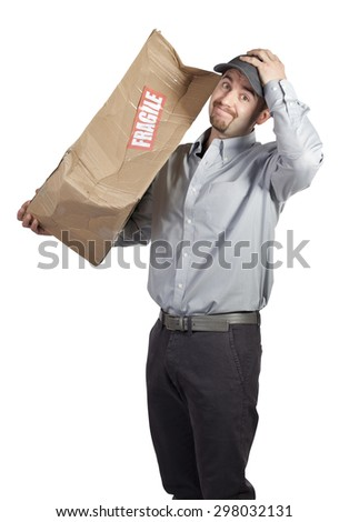 portrait of caucasian delivery man and damaged parcel - stock photo