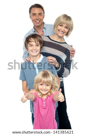 Portrait of caucasian family of four isolated over white - stock photo